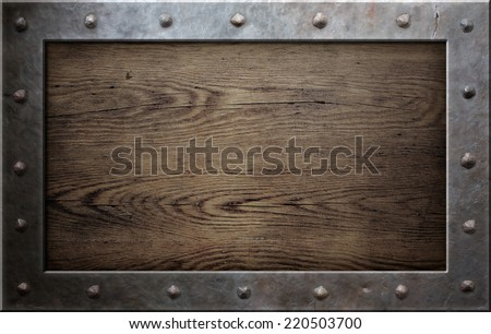 old metal frame over wooden plate - stock photo