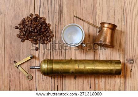 Old metal grinder coffee on the wooden table - stock photo