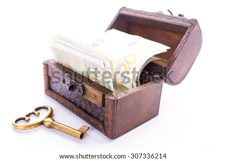 Old metal key and Serbian money in a wooden chest, isolated on white - stock photo
