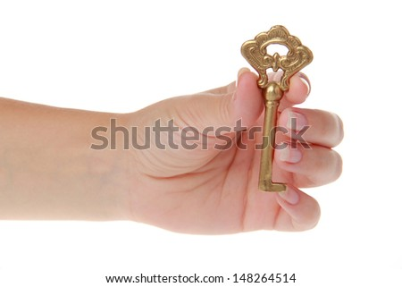 Old metal key in a hand isolated on white - stock photo