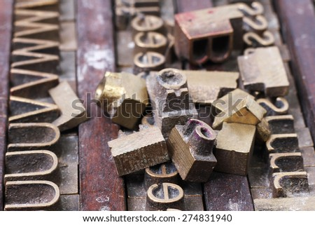Old metal letterpress printing blocks - stock photo