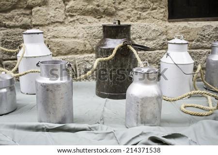 Old metal milk bottles urban street objects - stock photo