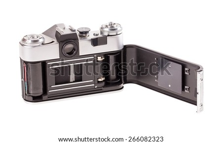 Old metal photo camera. Isolated on a white background.
