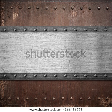 old metal plate over rusty background with rivets - stock photo