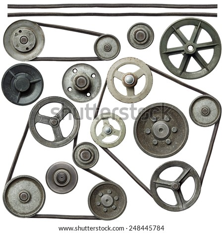 Old metal pulleys with belt. - stock photo