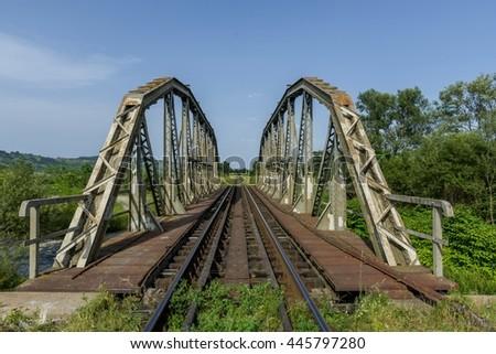 Old metal railroad bridge - stock photo