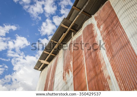 old metal sheet  wall and blue sky