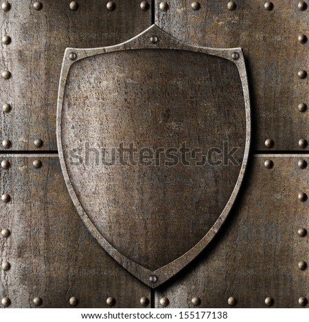 old metal shield over armour background with rivets - stock photo