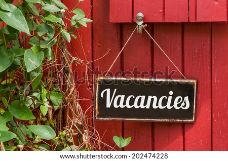 Old metal sign with the inscription Vacancies - stock photo