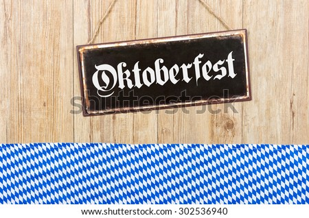 Old metal sign with the word Oktoberfest - stock photo