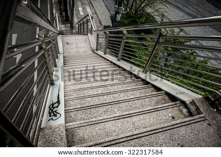 Old metal stairs of the overpass in Bangkok city thailand. - stock photo