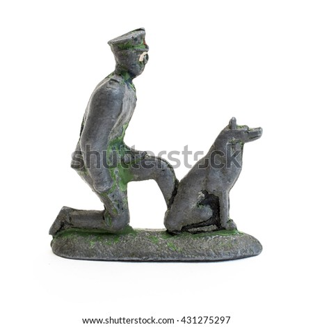Old metal toy soldier, made in the form of border guard with a dog.