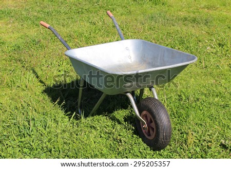 Old metal trolley on green grass