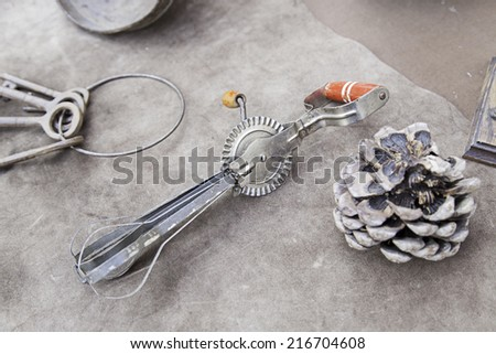 Old metal whisk, detail of a kitchen tool - stock photo