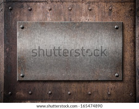 old metallic plate over rust metal background - stock photo