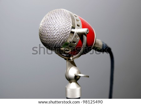 old microphone for singer with a gray background - stock photo