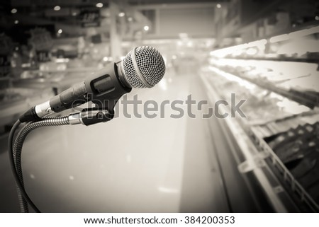 old microphone with blur store background