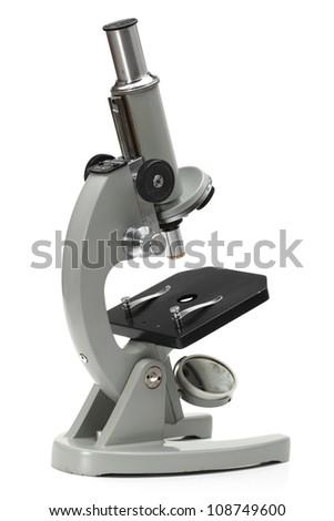 old microscope isolated on white background - stock photo