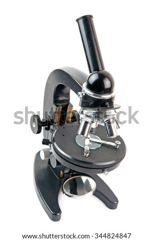 old microscope isolated on white background