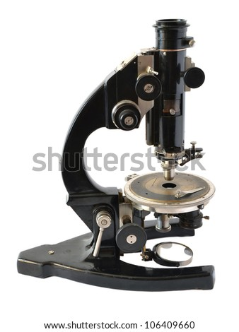 old microscope on a white background - stock photo