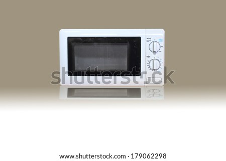 Old Microwave oven on gray and white background - stock photo
