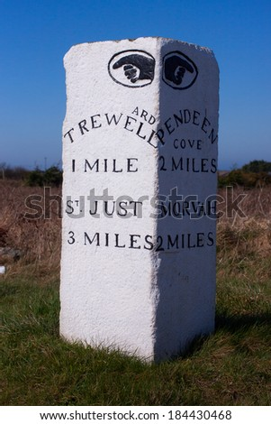 Old milestone at road junction, west Cornwall, UK. - stock photo