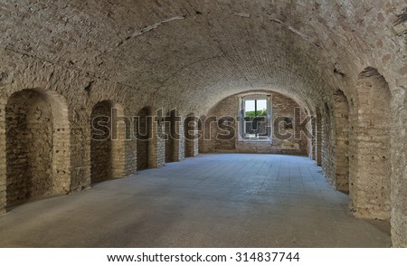 Old military barrack interior inside Bastion fortress in Slovak city of Komarno used in past as housing for soldiers . - stock photo