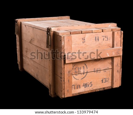Old military wooden box isolated on black - stock photo