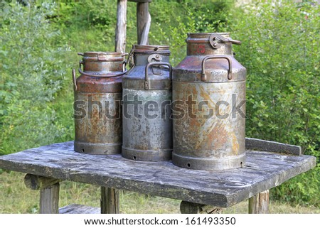 Old milk cans - stock photo