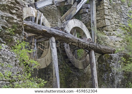 Old mill building with water mills in Kotli, a small hamlet on the upper reaches of Mirna - stock photo