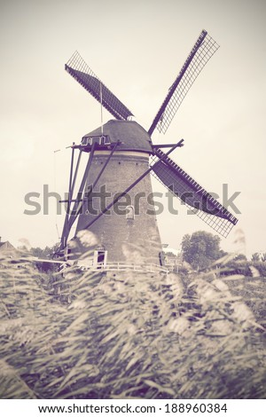 Old mill in Holland, stylization under an old card - stock photo