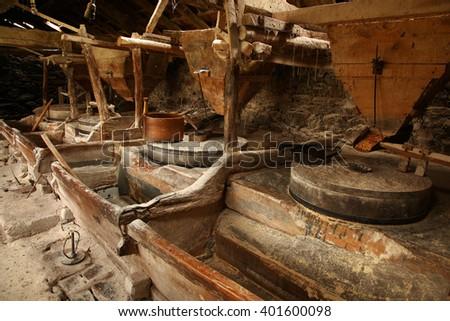 Old mill interior - stock photo