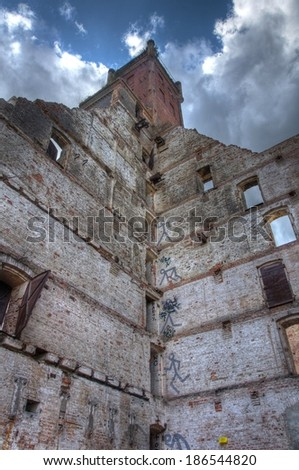 Old mill with cloudy sky - stock photo