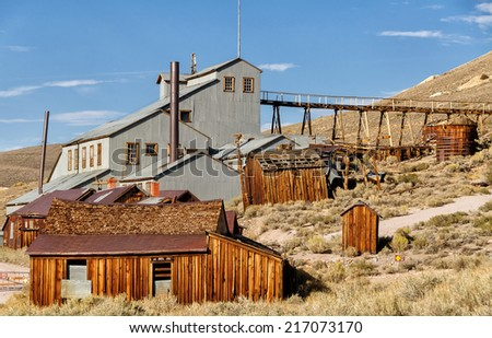 Old mine buildings in Bodie ghost town, state park in California - stock photo