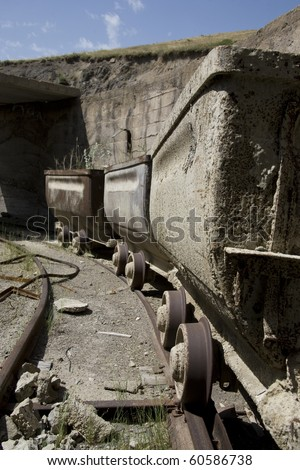 Old mine carts in a row - stock photo