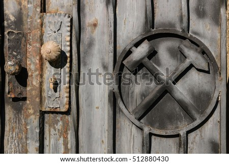 old mine gate with coat of arms and door knob & Old Mine Gate Coat Arms Door Stock Photo (Royalty Free) 512880430 ...