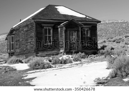 Old miners house in black and white, Bodie, California, USA. - stock photo