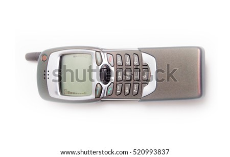 Old Mobile Phone. disposed obsolete phone on white background