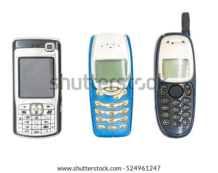 Old mobile phones on white background