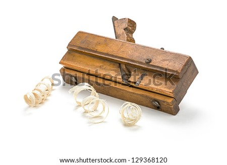 old molding plane with shavings - stock photo