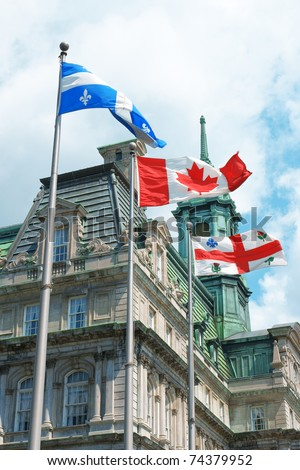 Old Montreal City Hall and Quebec, Canada and city flag - stock photo