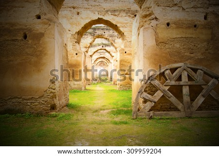 old moroccan granary in the green grass and archway  wall - stock photo