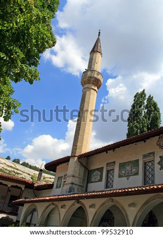 Old mosque with minaret.  Bakhchisarai, the Crimea, Ukraine - stock photo