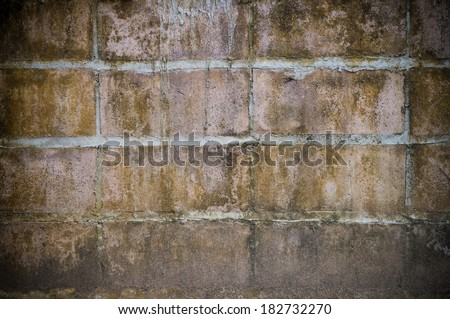 Old mossy brick wall background - stock photo