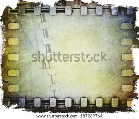 Old motion picture film reel with film strip - stock photo