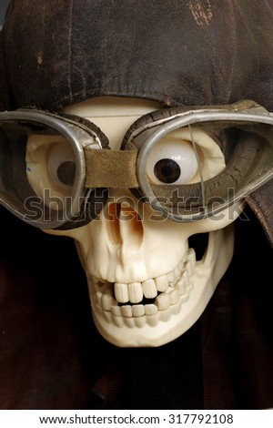 old motorcycle goggles and helmet the skull - stock photo