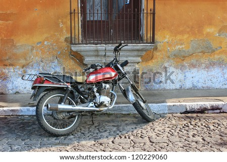 Old motorcyle in Colonial Antigua, Guatemala - stock photo