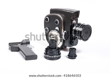 Old movie camera with lens and two additional lens isolated on a white background.