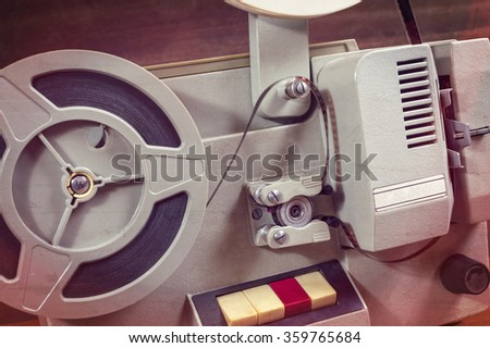 Old movie projector, selective focus. - stock photo