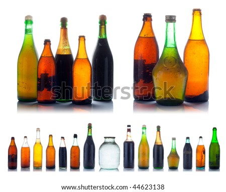 Old multicolored wine bottles set with natural dust and dirtiness